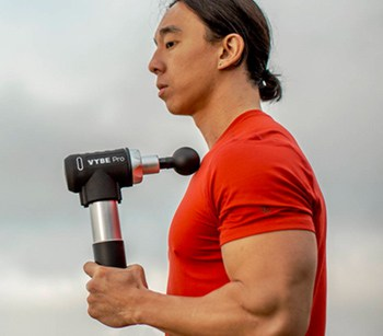vybe massage gun in use