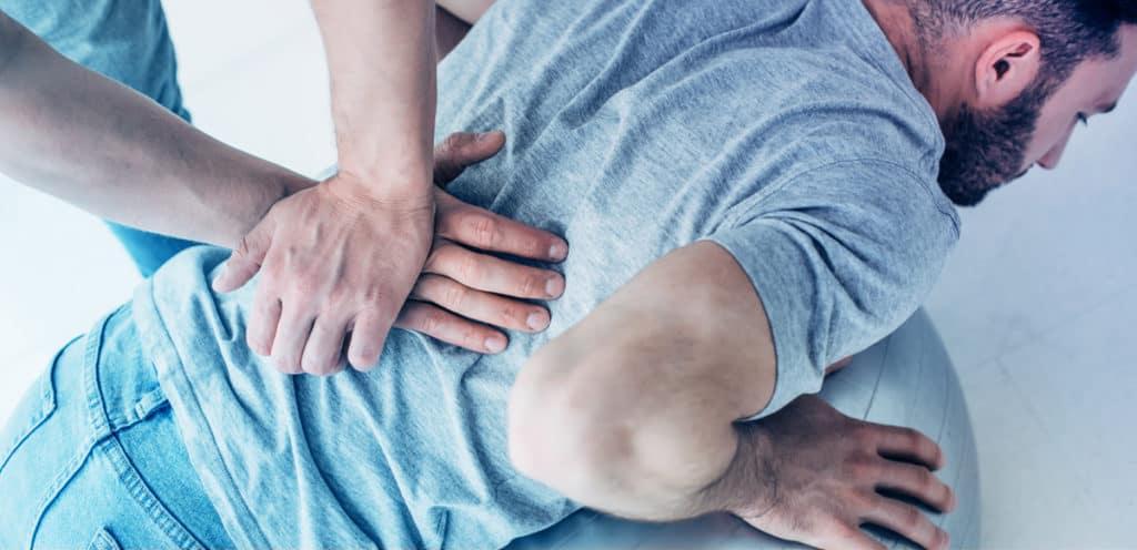 chiropractor massaging back